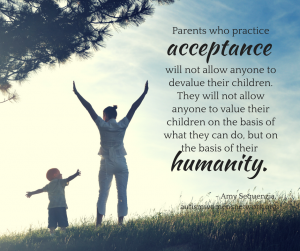 "Image description: photo of a parent and child standing side by side in a sunny field, with their arms raised and outstretched as they gaze at each other. Text says, ""Parents who practice acceptance will not allow anyone to devalue their children. They will not allow anyone to value their children on the basis of what they can do, but on the basis of their humanity. - Amy Sequenzia, autismwomensnetwork.org"""
