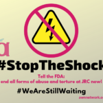 "Image: large electric shock icon (yellow triangle with black bolt of electricity) with a magenta 'no' symbol (circle and slash) over it. Smaller AWN logo beside the icon. Text says, #StopTheShock in black. Below it, ""Tell the FDA: end all forms of abuse and torture at JRC now!"" and #WeAreStillWaiting. Bottom corner says awnnetwork.org - Graphic design by Erin Human. Copyright © 2019 Autistic Women & Nonbinary Network (AWN)"